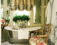 Striped balloon shade, soaking tub, orchid, planter in window - Charlotte Moss