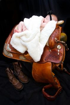 Country theme baby girl photos, Country western newborn photography, Baby poses in a saddle