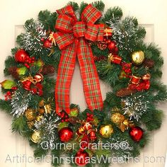 Thin Christmas Wreath - 2015 - GREAT FOR STORM DOORS! Our Thin Christmas Wreath is a tasteful blending of pine cones, snow tipped firs, red berries, Christmas balls and a beautiful red bow. This wreath is only (app.) 3'' in depth which should be thin enough to fit between storm doors! #ThinWreath