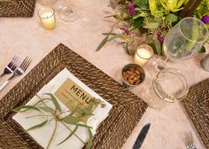 Our Elegant Farm Table look features a pink floral lace overlay atop a blush matte satin base; rattan square charger plates with an ivory satin napkin, butcher paper menu card, and eucalyptus tied with jut for a farm to table feel. Also included are rustic elements such as lanterns, jars and cheese boxes. #dressyourday FestivitiesMN.com
