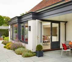 Garden room french Contemporary Orangery extension with French doors painted in Westbury Black Orangery Extension Kitchen, Orangerie Extension, Glass Roof Extension, Porch Extension, House Extension Design, Extension Ideas, Bungalow Extensions, Garden Room Extensions, House Extensions