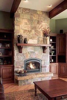 Stone Fireplace with Built Ins | Natural stone fireplace with dark built-ins, beams and mantle ... | H ...