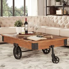 Enjoy a drink with friends while sitting around this unique cocktail table. Its funky design resembles a cart from an old factory, complete with weathered wood and metal wheels, and the table is durable enough for use as a coffee table.