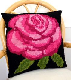 I have always wanted to design a big flower on a cushion and the Rose was the most obvious flower to choose.  There is a large coloured intarsia chart to follow to knit the rose and it is recommended that yarn bobbins are used for the different colours as it avoids the yarn tangling.  I have knitted the rose in 3 shades of pink, but you could use  other colours to reflect the wonderful range of roses that are available.    The cushion is knitted in Stockinette Stitch and is knitted in one…