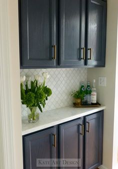 Before and After Kitchen Makeover Ideas.  BM Hale Navy paint, marble counter and tile, designer carried same hardware through from kitchen.