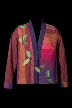 """This beautiful quilted jacket is made with hand-dyed cottons from Cherrywood Fabrics. We assembledtheir """"Cherry Roll"""" strips to make a large piece of fabricfrom which wecut the fron…"""