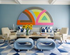 Although there are some midcentury chairs mixed in here, the patterns and wall art are iconic '70s. Notice all the different geometrics mixed in together with distinctively shaped furniture.