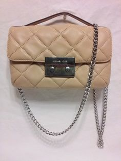 This  Gorgeous  Michael Kors Sloan Quilted leather crossbody bag would make a great addition to any wardrobe. Blush Quilted 100% Lamb Leather  Exterior ,Silver Hardware ,Flap with Clasp Closure, Top H