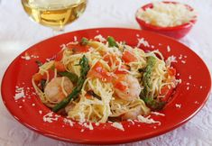 Fresh vegetables sauteed in garlic olive oil, then tossed with fresh angel hair pasta, shrimp and Parmesan cheese: a quick and easy, healthy dinner recipe.