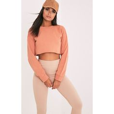 Beau Deep Peach Cut Off Crop Longsleeve Sweater ($15) ❤ liked on Polyvore featuring tops, sweaters, deep peach, cropped sweater, cut-out crop tops, crop top, peach sweater and red crop top