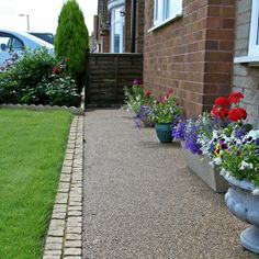 Resin bound surfacing used along the front of a bungalow.