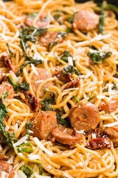 Spaghetti with Sun-Dried Tomatoes, Sausage, and Spinach. Sub coconut milk for heavy cream and use whole wheat pasta.