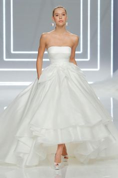 Rosa Clará 2017 straight across strapless ball gown wedding dress with tiered high-low hemline and large front bow