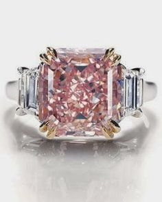Extremely rare fancy intense pink diamond ring in platinum