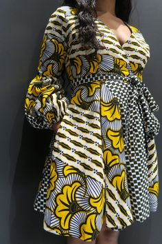 african fashion Invented by Diane von Furstenberg the Wrap dress is flattering, versatile, and easy to wear, pack, and style. Every woman needs this wrap dress in her closet. Short African Dresses, African Blouses, African Print Dresses, African Fashion Ankara, Latest African Fashion Dresses, African Print Fashion, Kitenge Designs Dresses, Ankara Designs, Ankara Mode