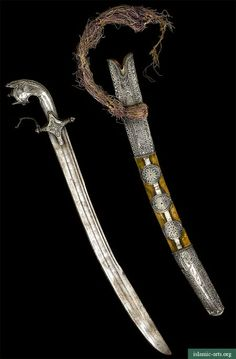 AN ARABIAN SILVER-HILTED SWORD AND SCABBARD, 19TH CENTURY