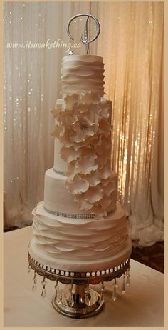 .stunning cake with petals and ruffles
