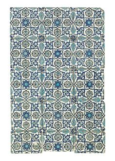 A DAMASCUS TILE PANEL OTTOMAN SYRIA, CIRCA 1560 Comprising fifteen tiles, each painted in cobalt-blue, black and turquoise on a white ground with a central rosette issuing blue split palmettes containing cloudband-motifs and flanking four black palmettes, three tiles reduced, otherwise intact, framed together 37¼ x 23½ in. (94.5 x 59.7 cm.)