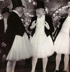 Top hats and tutus. Now that's a combo you don't see every day. Particularly not on men. Worth a smile. :)