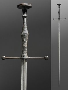 Tuck (Panzerstecher)  Artist/maker unknown, German or Austrian  Geography: Made in the German-speaking lands, Europe Date: c. 1500-1525 Medium: Steel [blade]; blackened iron, wood, canvas, textile [hilt] Dimensions: Length (Overall): 50 1/4 inches (127.6 cm) Pommel: 2 3/8 × 2 inches (6.1 × 5.1 cm) Width (Quillons): 7 15/16 inches (20.2 cm) Blade: 7/8 × 40 7/8 inches (2.2 × 103.9 cm) Depth (Quillon Block): 7/8 inches (2.3 cm) Weight: 3 pounds 7.6 ounces (1575g)