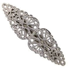 Set in a shining silver tone, this hair barrette is sure to make a stylish statement! Two wing shapes are connected at the center and gradually get thinner towards the ends of the barrette. Stamped with a vintage inspired filigree design, use this hair accessory to achieve any style.