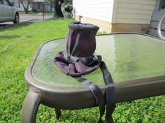 "Steampunk Mini Top Hat ""Screwed on Tight"". $18.00, via Etsy."