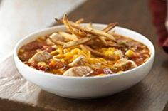 Chicken Tortilla Soup recipe-A Southwestern cousin of mom's chicken soup, this one has a little more kick with a crispy topping. And, like its best-loved relative, it'll make you feel good all over.