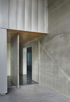 minimalist house architecture modern revolving front door concrete