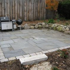 Do-It-Yourself How to Build a Dry Stone Patio | I like the natural stone border