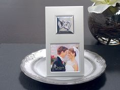 #2 Two Hearts Metal Photo Frame (Cassiani Collection 4157) | Buy at Wedding Favors Unlimited (http://www.weddingfavorsunlimited.com/two_hearts_silver_metal_photo_frame.html).