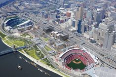 This image is how Cincinnati looks like today. The imagery is a lot more colorful, and it has 2 separate stadiums. Gentrification had improved the Cincinnati Riverfront to make it more attractive for people. Cincinnati Parks, Cincinnati Bengals, Cincinnati Skyline, Cruise Boat, City Pages, Ohio River, Commercial Real Estate, Great Places, Amazing Places