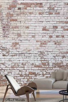Distressed Brick Wallpaper looks stunning in this living room. The realistic design adds tons of texture to walls and it's even washable. The decaying white paint over red bricks creates an industrial, loft look. Brick wallpaper from About Murals is easy to hang, removable and eco-friendly. Brick Wallpaper Living Room, Faux Brick Wallpaper, Industrial Loft, Red Bricks, New Shop, White Paints, Wall Murals, Eco Friendly, Walls