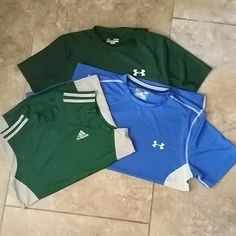 UNDER ARMOUR/ADIDAS MEN'S SHIRT BUNDLE An Under Amour blue and silver fitted shirt, a Green compression muscle tee and a green compression fit T. All larges. No rips or stains. Smoke free home. THESE ARE MEN'S SHIRTS. Under Armour/Adidas Tops Tees - Short Sleeve