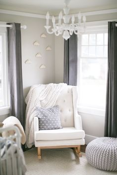This gender neutral nursery would be sweet for baby boy or girl! Graced in gray and layered with sweet touches, you can find more right here.