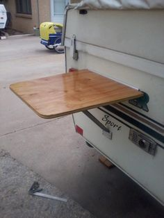 Pop-up table or bar. Consider mounting one under sliding window by kitchen to get a pass-through for buffet-style dining. Or use one of these between two chairs for your side table - maybe under awning space. A Frame Trailer, Pop Up Camper Trailer, Pop Top Camper, Camper Trailers, Best Pop Up Campers, Airstream Campers, Airstream Interior, Vintage Airstream, Trailer 2