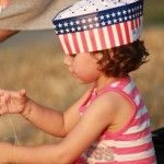 A little girl in her red, white, and blue during last summer's July First Friday