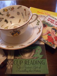 Tea:  A vintage fortune-telling china teacup and saucer, with guides to reading tea leaves.