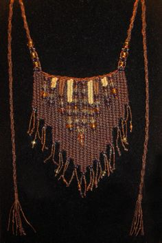 """Cape May"" - 2013 - Modeled after ""Seashore.""  Adjustable length, glass beads, SOLD.  Woven by Terri Scache Harris, theravenscache.shutterfly.com   Hand woven, handwoven, weaving, weave, needleweaving, pin weaving, woven necklace, fashion necklace, wearable art, fiber art."