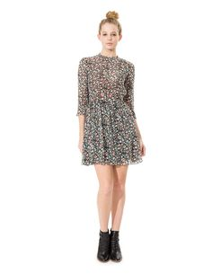 The Fedora dress may remind you of the 90s, though theres nothing dated about this above-the-knee number. Slightly sheer long sleeves and a floral...