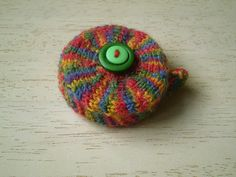 This tape measure cover uses only a small amount of sockweight yarn and would make a good present for any knitter. The pattern is for a cover to fit a round tape measure with a diameter of 5cm.