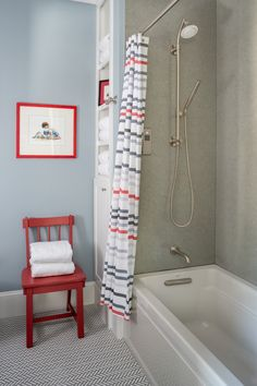 beach themed bathroom idea beige walls light blue wall with wall art multicolored mosaic tiles floors Whirpool bathtub in white red chair multicolored shower curtain with stainless steel curtain rod of Great Choices of Fancy Colors for A Small Bathroom