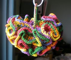 crocheted Boutonniere Dishcloth or Dish Mop  (done with size #10 thread, no hook size given, I would suggest a #7 steel hook).