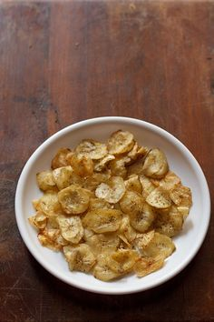 banana chips or banana wafers recipe - easy and simple homemade banana chips made from raw banana. these banana chips can also be had during fasting.