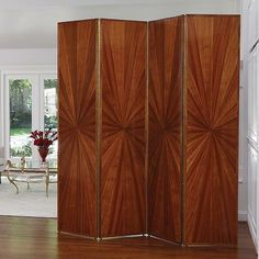 Taking a nod from the 1920s, we are bringing Art Deco glam into the present! Our Sunburst Floor Screen features rich, warm mahogany wood veneer that shines beautifully in a sunburst pattern. The four folding panels connect by continuous brass plated steel piano hinges and are finished on both sides, creating a look that can float easily in any room. #globalviews #topfurniturefavorites #instock