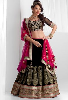 Pure velvet ghagra, rawsilk and brocade blouse and net dupatta embellished with thread, pearls and stone work