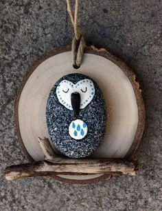 Sleepy barn owl, painted rock on wood slice, ornament, rain, found art, pebble, round, grey and turquoise, owl on branch, stick by DeborahMcGeeArt on Etsy