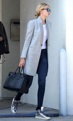 Gigi Hadid // low bun, mirrored sunglasses, grey jacket, white tee, skinny jeans, Saint Laurent bag & silver sneakers