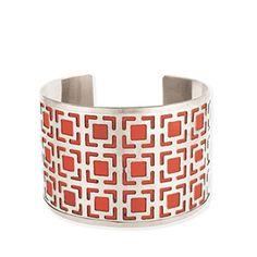 Red Geometric Cuff Bracelet.  Silvertone metal alloy cuff features red leather layered beneath geometric square filigree. Antique finish.
