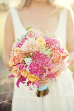 Orange and pink bouquet with succulents - Image by Photography by Nadean