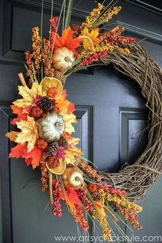 This project piles it all on with fruit, leaves, pumpkins and pinecones, just to name a few components —but just on one side of the wreath. Try an asymmetrical design for something a little more unexpected, and DIY your own dried orange slices by baking them in the oven. Click through for the tutorial and more easy DIY fall wreaths.